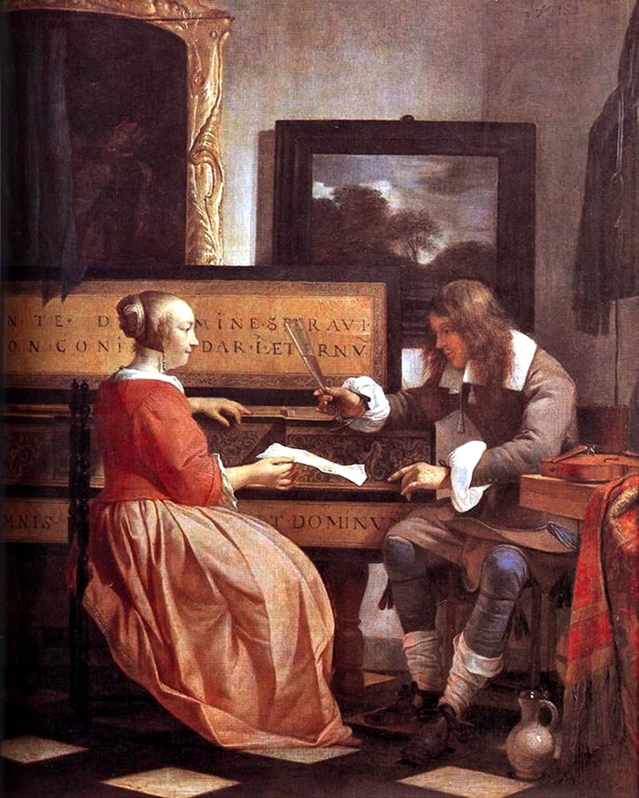 Мужчина и женщина, сидящие у вёрджинела