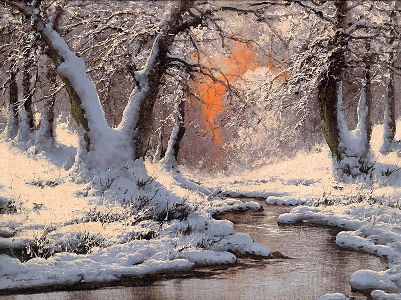 Закат над зимним речным пейзажем.