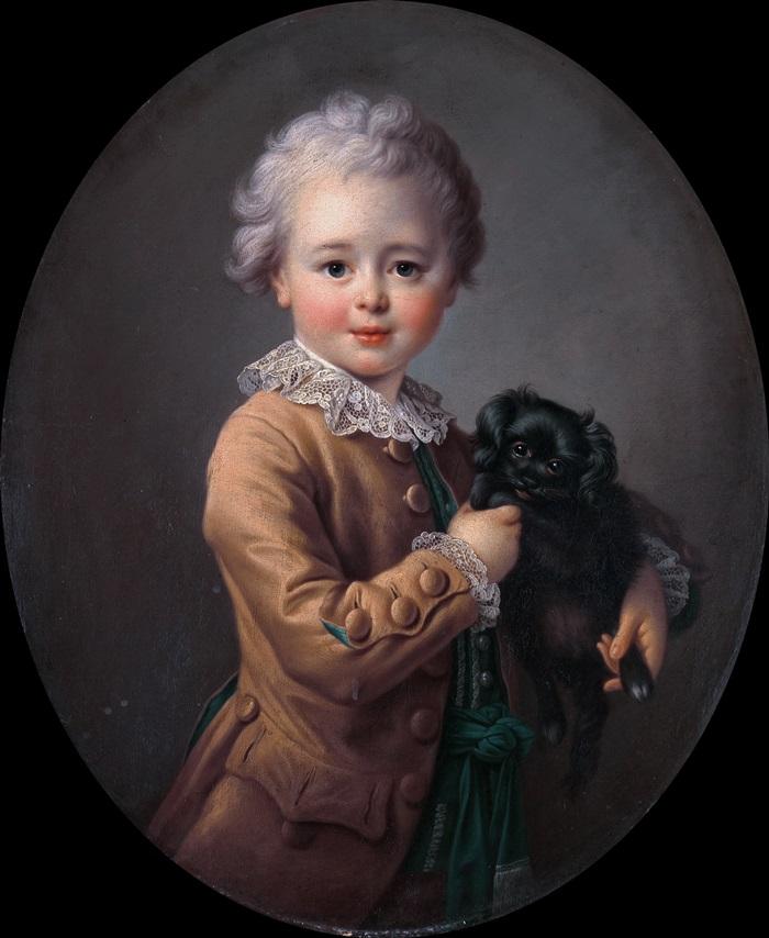 Мальчик с черным спаниелем