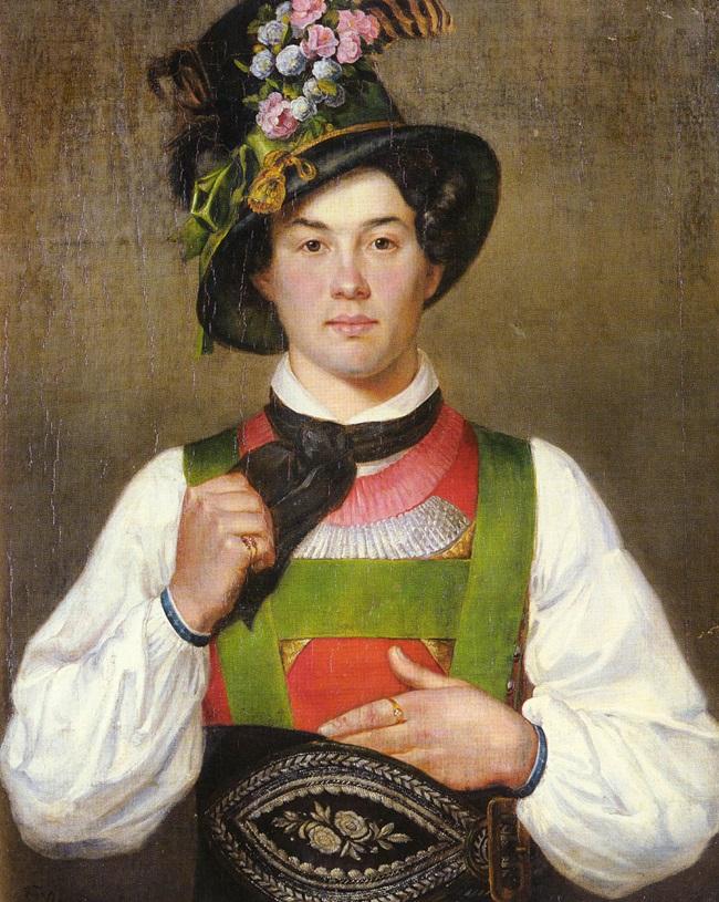 Молодой человек в тирольском костюме