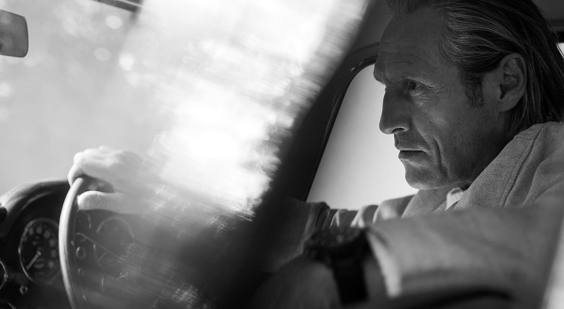 Robert Knighton in an Aston Martin DB5 Superleggera