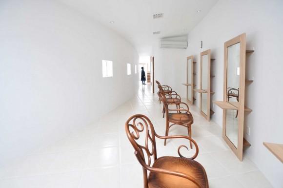 Curved-Little-House-Barber-Interior-Design-580x385