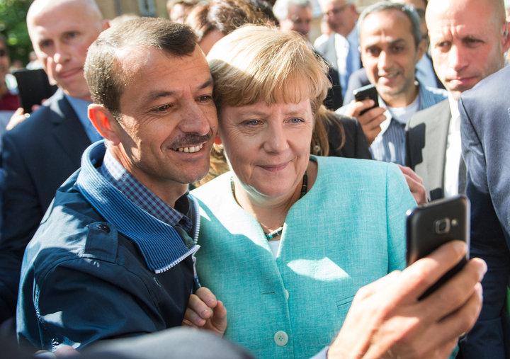 Меркель и беженцы