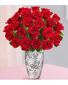 One dozen roses in a silver-plated, embossed vase