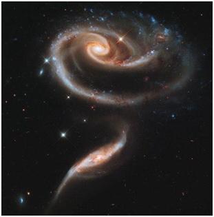 В честь празднования 21-й годовщины развертывания на орбите космического телескопа Hubble астрономы направили его на невероятно красивую группу взаимодействующих между собой галактик Arp 273.