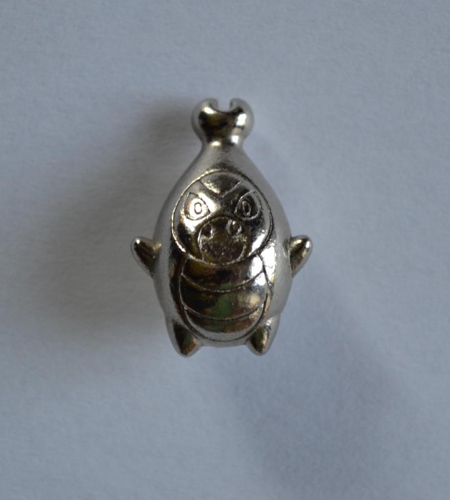 Silver Karrablast Figure