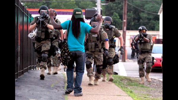 081314-National-Whats-Happening-in-Ferguson-Police-Riot-Gear-Arresting-Man.jpg
