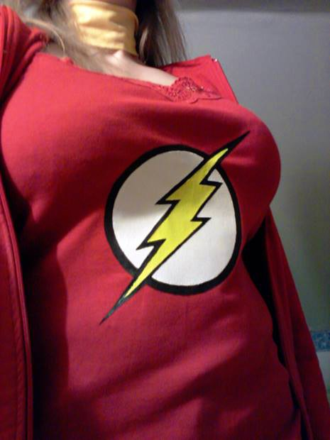 A woman wearing a spaghetti string t-shirt with Flash logo
