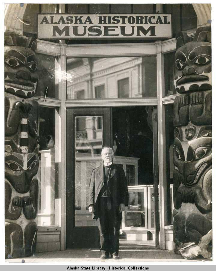 Rev_AP_Kashevaroff_standing_outside_the_Alaska_Historical_Museum