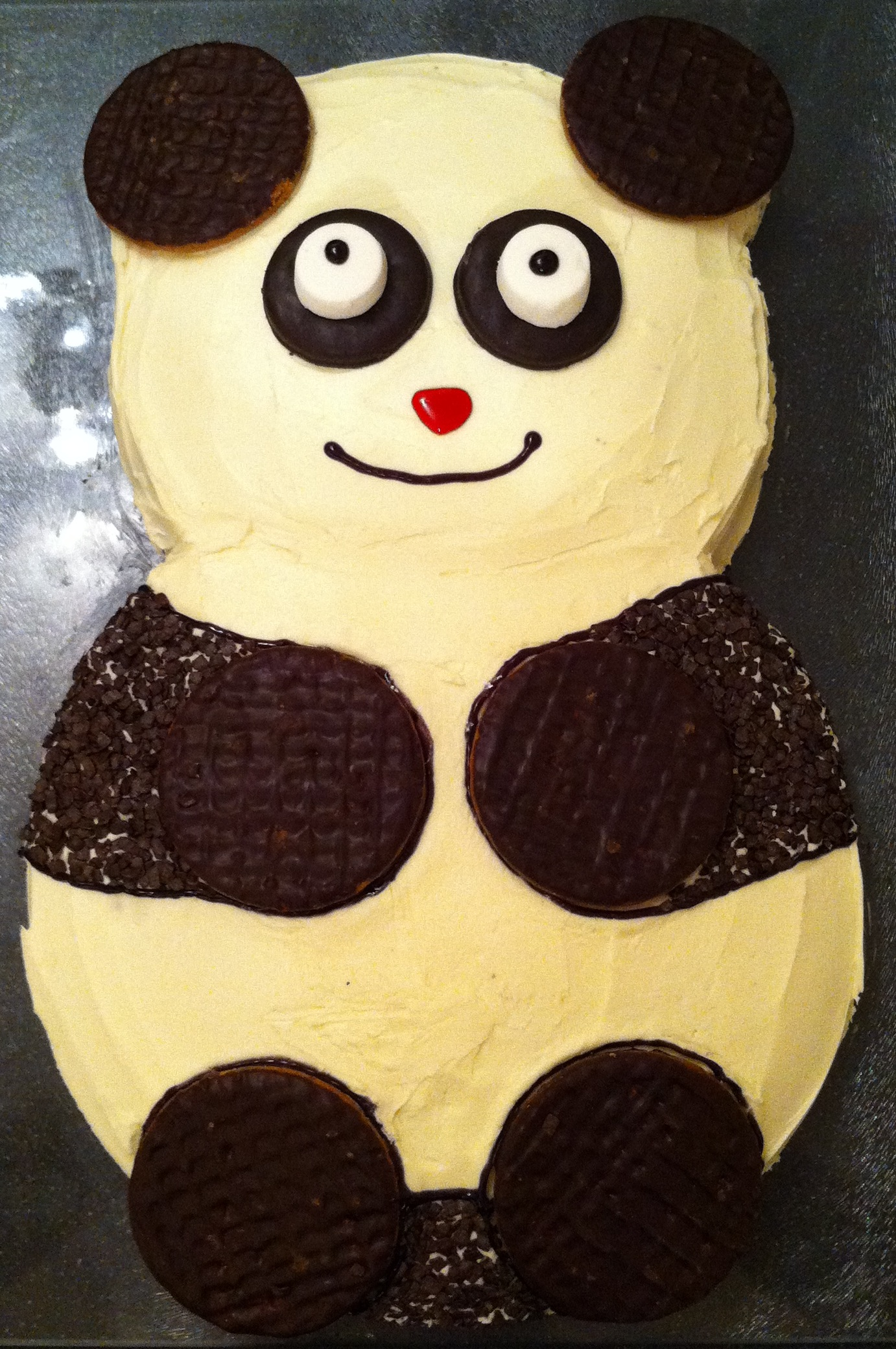 A gorgeous birthday cake of a somewhat cartoon-ish panda.