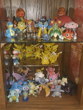 Some various Tomy figures, other figures, and my unintentional Pika collection