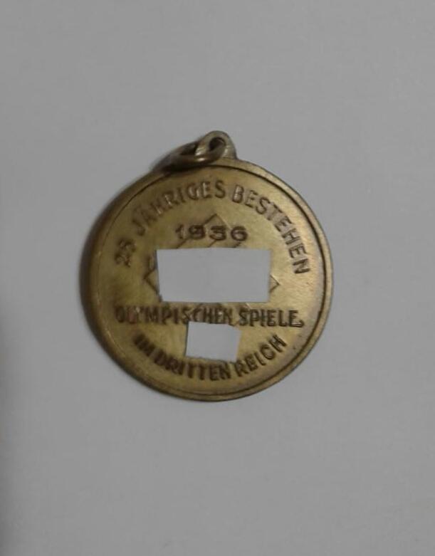 """Реверс медали из моей коллекции. В центре — свастика. Надписи - """"25 летие Олимпийских игр в Третьем рейхе. 1936 год"""""""