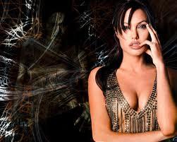 Джоли призналась, что удалила себе обе груди 5657