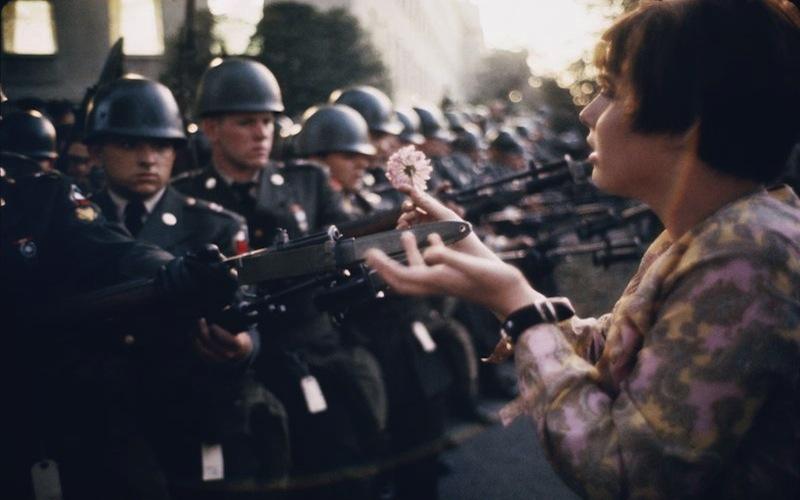 hippie_puts_flower_in_gun