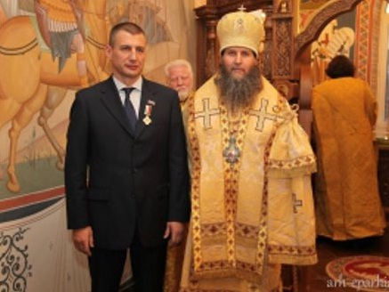 Александр Дятлов и РПЦ с медалью