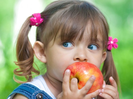 Little-Girl-Eating-Apple