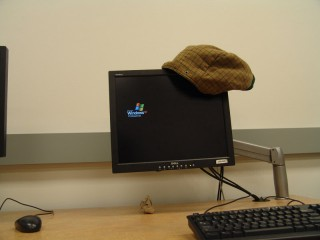 A hood hanging from a computer monitor