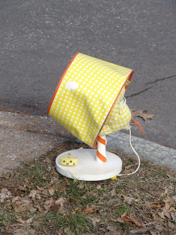A children's lamp left on a traffic island