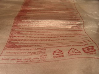 A plastic bag with a warning printed in many languages