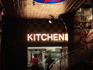 KITCHEN spelled out in dots of light