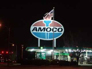 A large Amoco sign tops a BP station