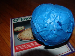 A tapeball and a flier titled O'Imos