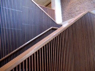 A staircase sided with strips of wood panelling