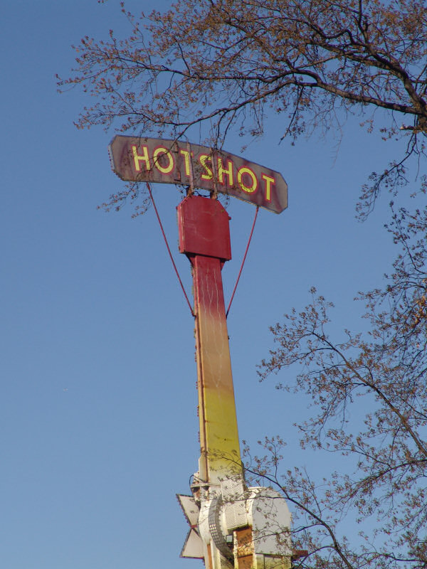 Hotshot sign tops a carnival ride