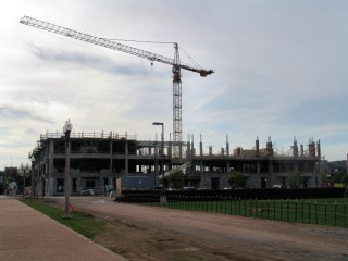 A crane towers above the rising concrete structure of the new Political Science and Economics building