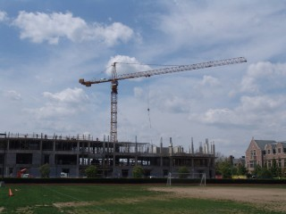 A crane towers above the rising concrete structure of the new Political Science and Economics building(!)