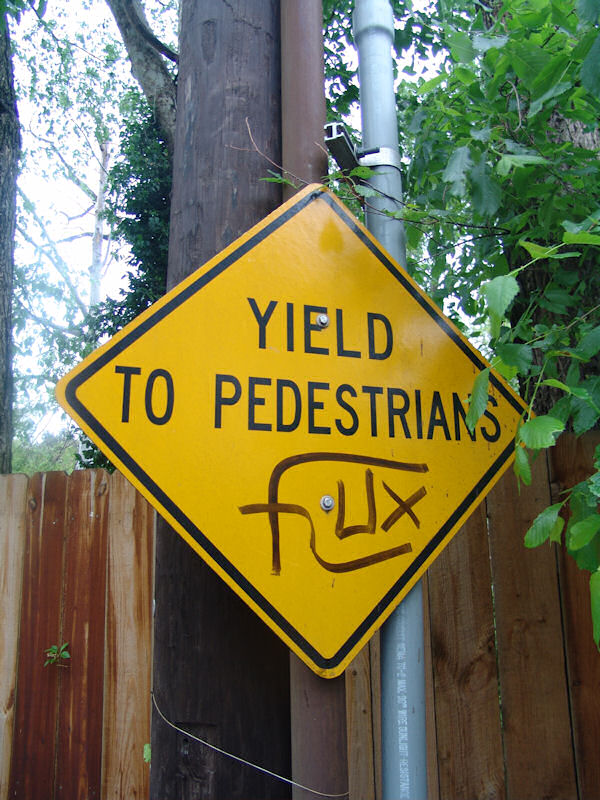 """Diamond road sign: Yield to Pedestrians, with graffiti tag """"Flux"""""""