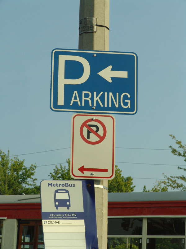 Parking and No Parking signs, both pointing left