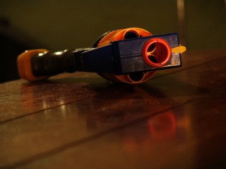 A Nerf six-shooter on a table