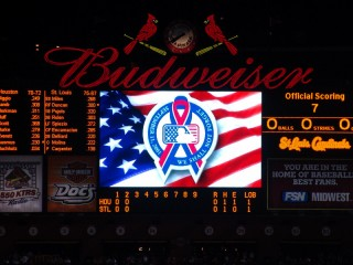 Scoreboard at Busch Stadium displaying 'We Shall Not Forget'