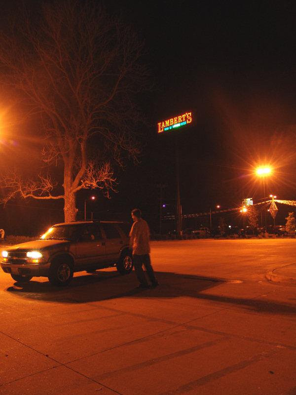 Parking Lot of Lambert's -- Home of Throwed Rolls