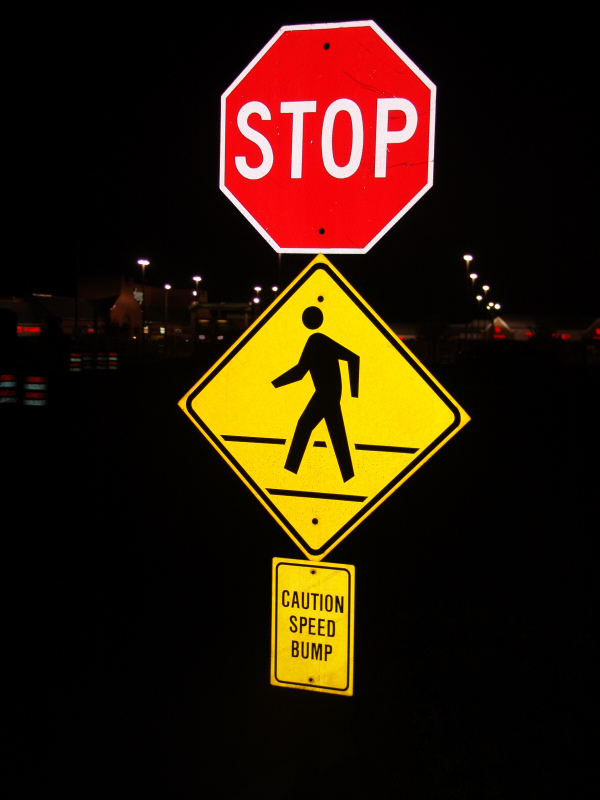 Stop Sign, Graphic Ped Xing Sign, and Caution Speed Bump Sign