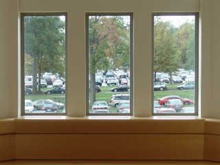 A parking lot through a set of three windows