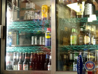 Refrigerator containing Beers, Glasses, WD-40, other alchohol,...