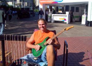 Smiling guitar player-Justin Herman Plaza