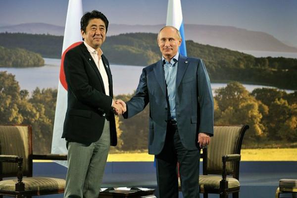 олимпиада 2014; встреча Путина и Синдзо Абэ
