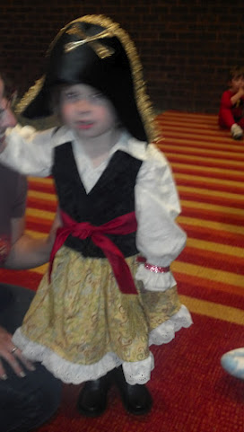 photo of a young girl dressed as a pirate