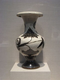 Vase with carved-slip decoration of lotus bouquet