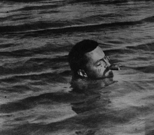 Steinmetz is swimming with having a cigar in his mouth