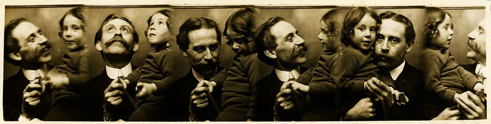 """The Brighton photographer Abraham Dudkin (1876-1949), proprietor of the Sticky Backs Studio at 54 North Street, Brighton, pictured with his son Lewis Stanley Dudkin (born 1909, Brighton) in a series of """"automatic"""" photo strips produced around 1913"""