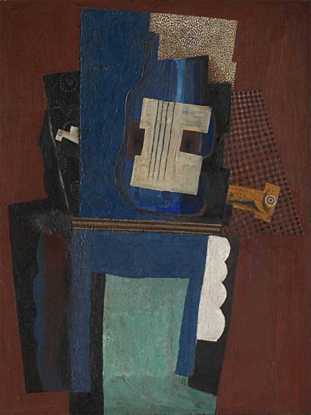 Гитара и кларнет на камине П.Пикассо