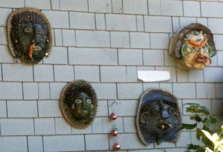 Masks with bonnets, caterpillars, fangs, and slugs