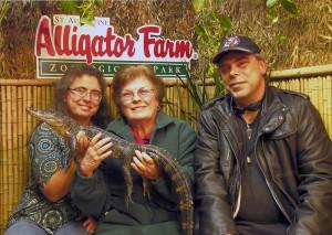 Family + sad baby gator at the Saint Augustine Alligator Farm