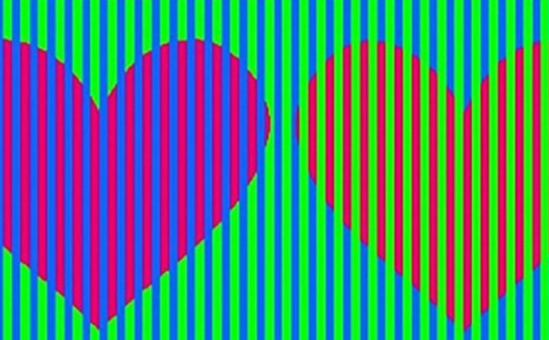 """На этой картинке кажется, что два сердца имеют разные цвета: левое фиолетовый, а правое красный. """"На самом деле"""", оба сердца имеют одинаковый цвет."""
