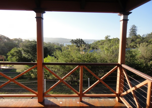Wooden balcony, harbour view across treetops