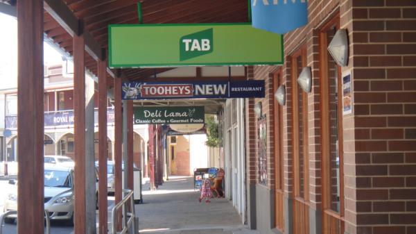 Street corner country town, covered sidewalk, pub, TAB